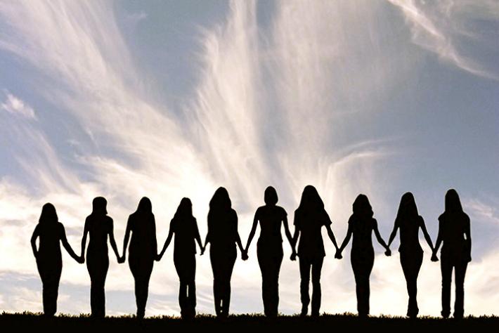 women_holding_hands